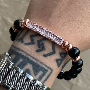 Rose gold plated baguette cz bar & onyx beads